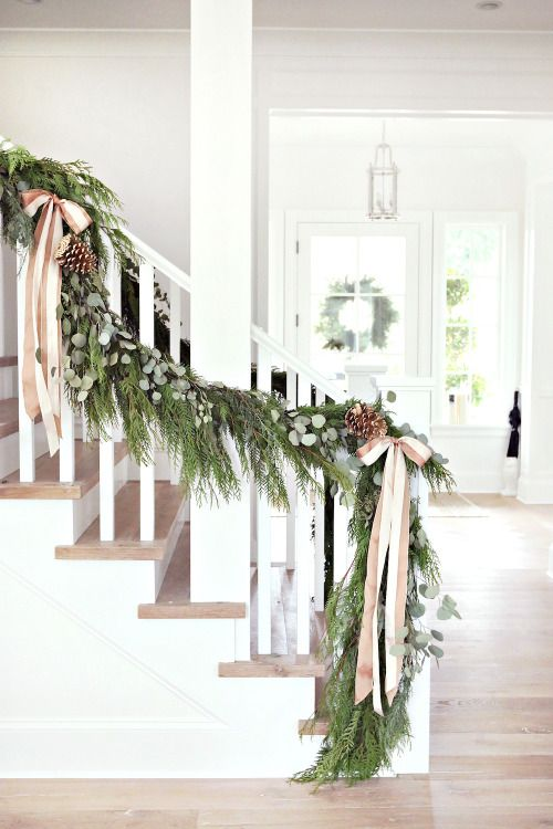 Pretty ribbon and garland going up the stairs