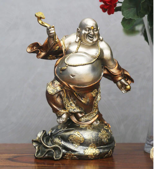 laughing buddha on the table