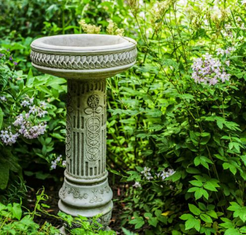 Tall stone cast garden bird bath